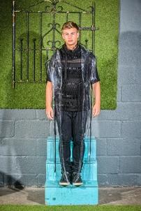 Cameron Kelly in A PVC Mac, Woven Woolen Jumper by Jamie Russell, Jeans, Stylists Own @ West Coast Cooler FASHIONWEEK