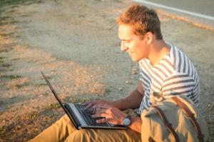 man sitting laptop