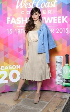 Rebecca Maguire in Beige Suede Tee, £28.99 @ DV8, Blue Suede Jacket, Stylist's Own, Beige Pleated Skirt, £50.00 @ Warehouse @ West Coast Cooler FASHIONWEEK