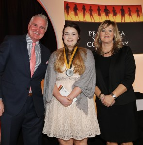 Megan Daly with Brent Pope and Andrea McBride from Pramerica Systems Ireland