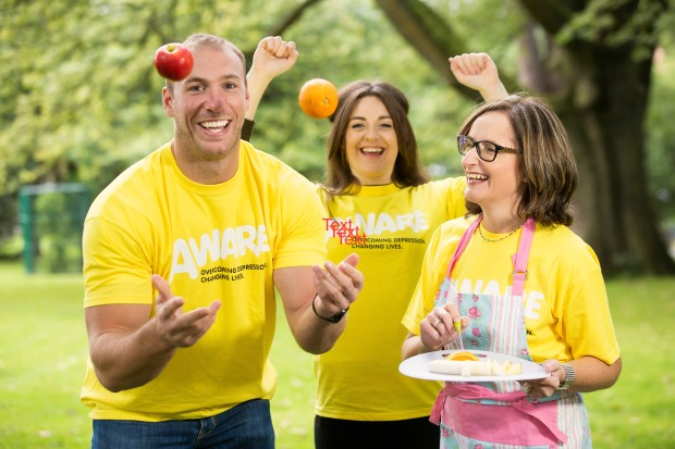 Stephen Ferris with AWARE chief executive, Siobhan Doherty and AWARE ambassador Rebecca Dempsey